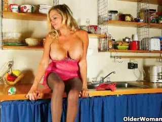 Mom is cleaning the kitchen in pantyhose