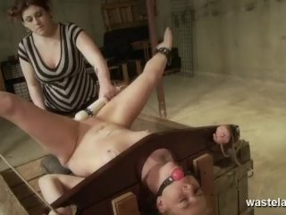 Blonde female sex slave is ball gagged