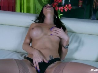 Busty Dava plays with her wet pussy