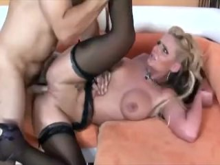 Busty babe fucked on a couch in black nylon