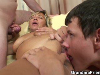 Two young dudes bang pretty mommy