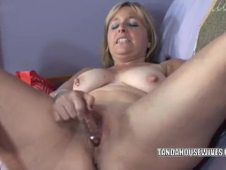 Liisa is stuffing her wet twat with a toy