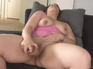 Foxy busty babe masturbating with a vibrator