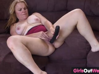 Busty mature lady masturbates with big black cock
