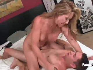 Sexy milf is having sex with a young guy
