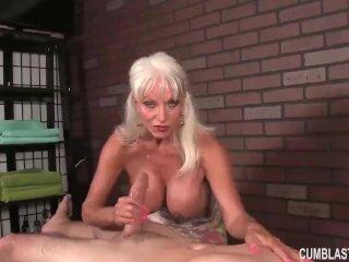 Huge-titted woman handjob