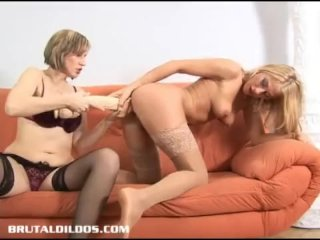Dionne has help gaping her pussy with a brutal dildo
