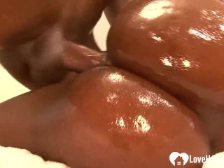 Oiled up black babe with big tits penetrated