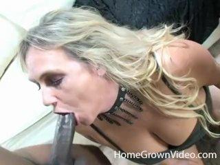 Busty blonde mature sucks two black cocks