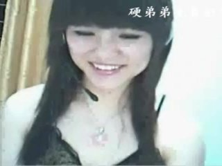 Petite Chinese girl toys her hairy twat on webcam solo