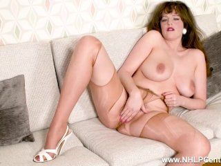 Busty brunette Kate Anne fingering her wet hairy pussy in shiny pantyhose
