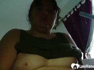 Chubby babe plays with her wet cunt