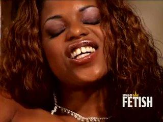 Ebony babe with curly hair masturbates on the stairs