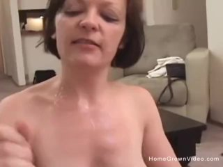 Cock gobbling amateur whore sucking two cocks