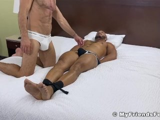 Hunky black guy restrained and tickled in a kinky threesome