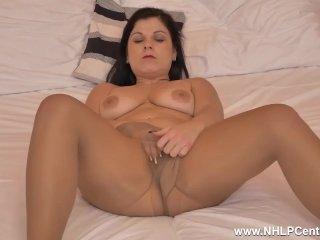 Buxom brunette Belisa masturbates with dildo toy in ripped nylon pantyhose