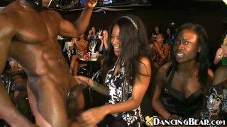 Girls having fun with masked ebony stripper