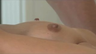 Hot MILF enjoys oily fingers deep in pussy