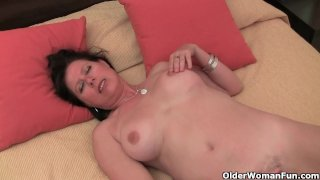 Hairy mature lady strips and finger fucks