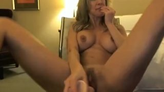 Busty blonde babe playing with dildo