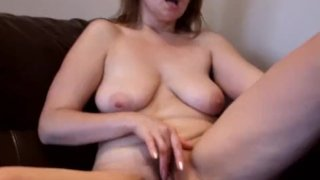 Mature housewife rubs her clit