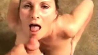 Busty babe gives titjob and gets huge cumshot