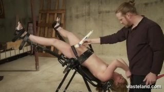 Master ties her down for rough electic play