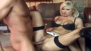 Blonde dped in black thigh high fishnets