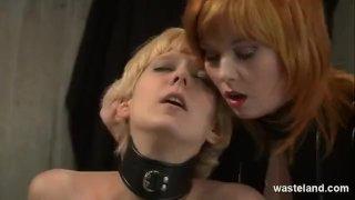 Redhead lesbian dominatrix uses blonde sub