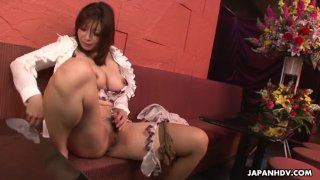 Fetching Japanese gal plays with her wet puss