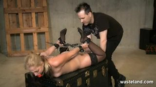 Tied blonde slave gives Master a footjob