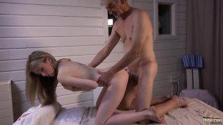 Skinny blonde gives old man erotic massage