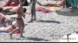 Teeny girls have fun at the nude beach