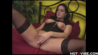 Brunette hottie plays with her pussy