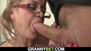 Old woman rides cock in the office