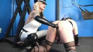 Strapon mature blonde Domina has a sissy on all fours to train his ass
