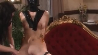 Latex mistress torments masked lesbian submissive