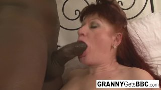 Euro granny redhead teases the camera and the big black cock
