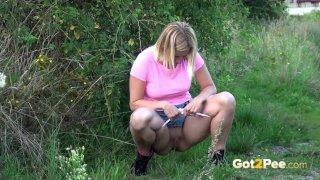 Blonde Pissing In The Field