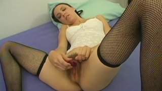 Brunette in pigtails uses a toy on her hairy pussy
