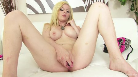 Horny blonde with big tits plays with her glass toy
