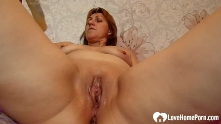 Amazing mom uses a toy on her cunt