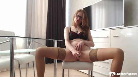 Beautiful secretary in stockings fists her ass